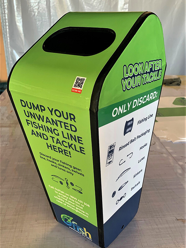 Bin covered with Green poster